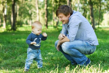Happy father and baby boy son outdoor