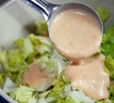 Portioned Out Serving Of Salad Dressing