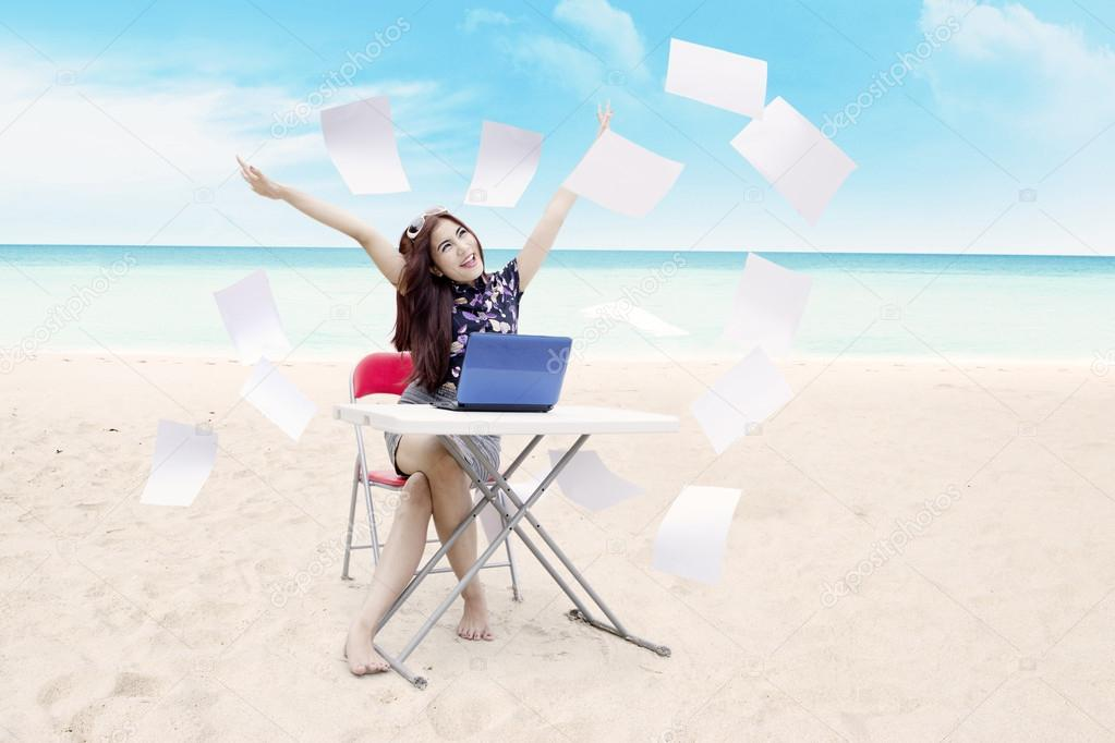 Succesful businesswoman at beach