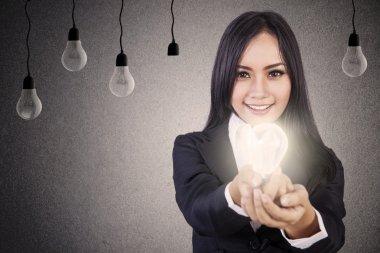 Businesswoman give bright idea
