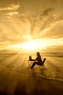 Amazing rays of light of woman study on beach