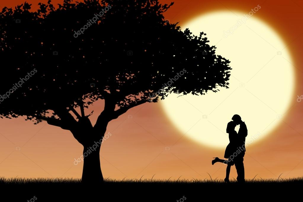 Couple kissing by orange silhouette and tree