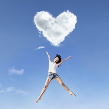 Girl big jump under heart clouds