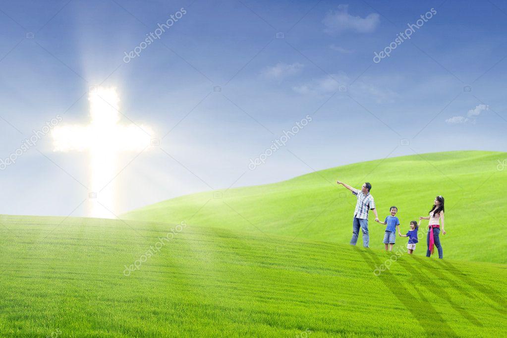 Christian family walk toward the light