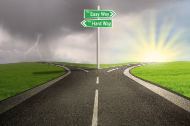 Road sign of easy vs hard way on highway