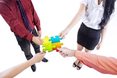 Business team building puzzle