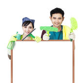 Photo Cleaning service couple holding copyspace