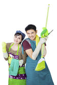 Photo Couple hold cleaning tool on white