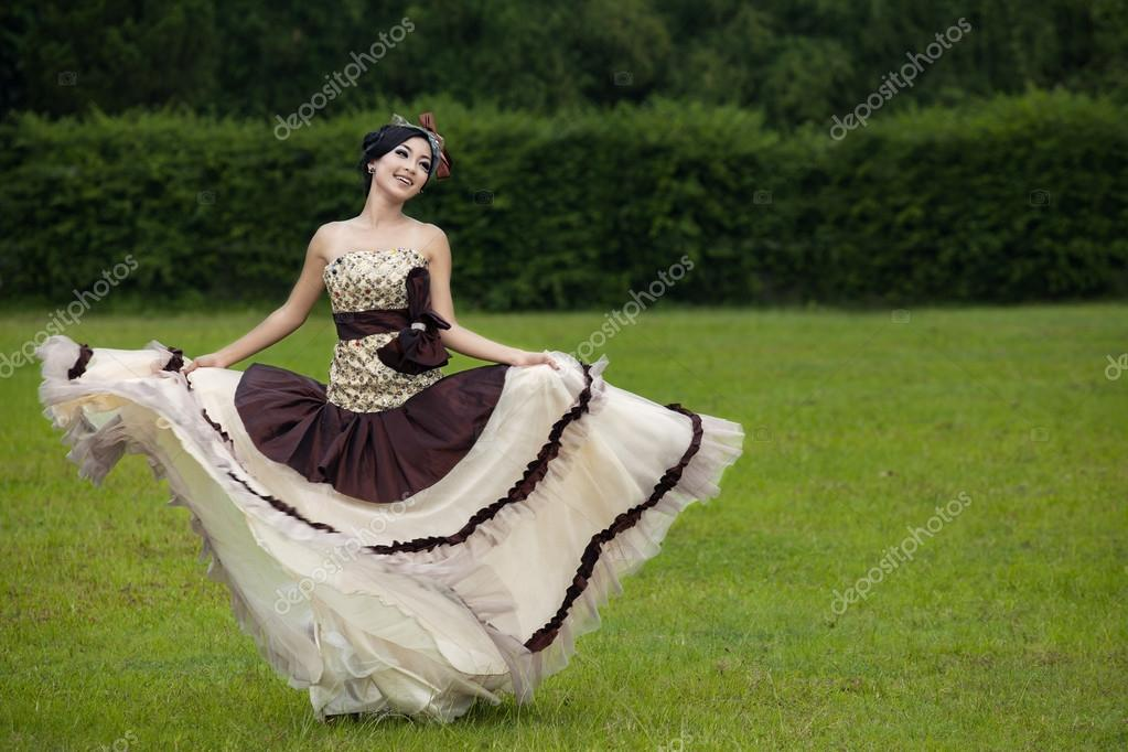Beautiful woman dancing with formal dress