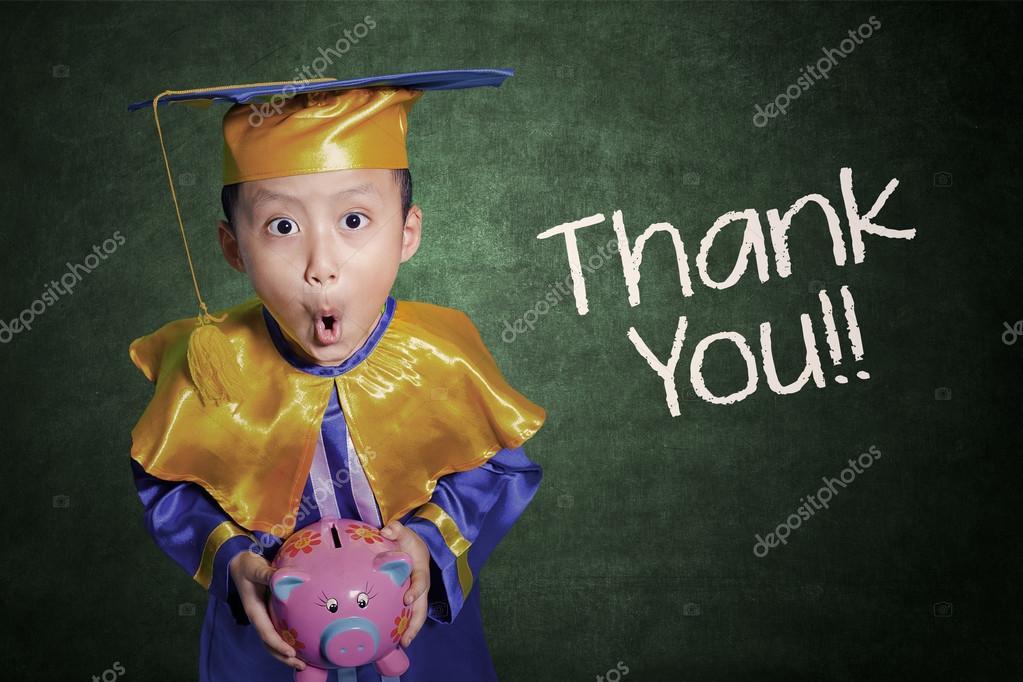 Boy with graduation gown holding piggybank — Stock Photo ...