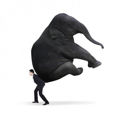 Businessman carrying heavy elephant