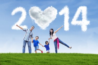 Happy family with cloud of new year 2014