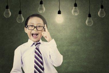 Asian schoolboy convey his idea