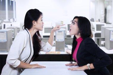 Businesswomen fighting