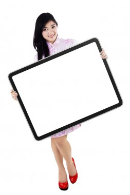 A woman holding blank board