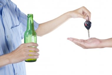 Alcoholic giving a car key to someone