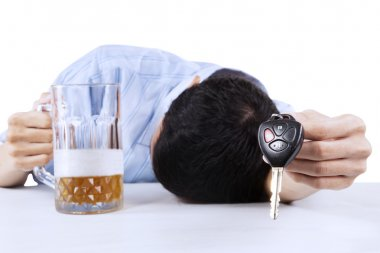 Alcoholic offering a car key