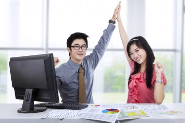 Excited two business people at office
