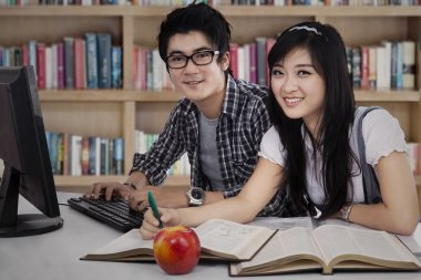 Two college students studying together