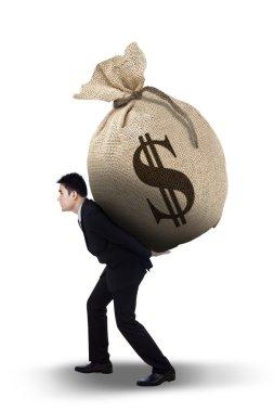 Businessman carrying money bag