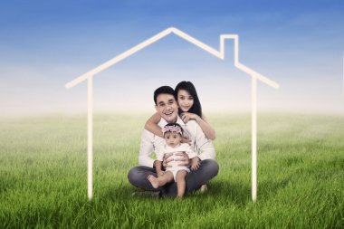 Happy family dreaming a home