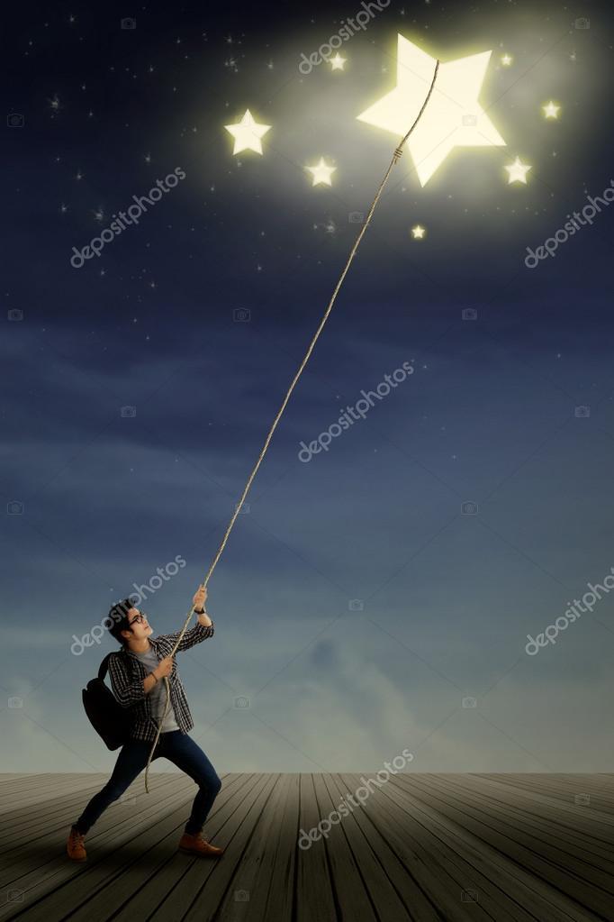 Male student pulling stars