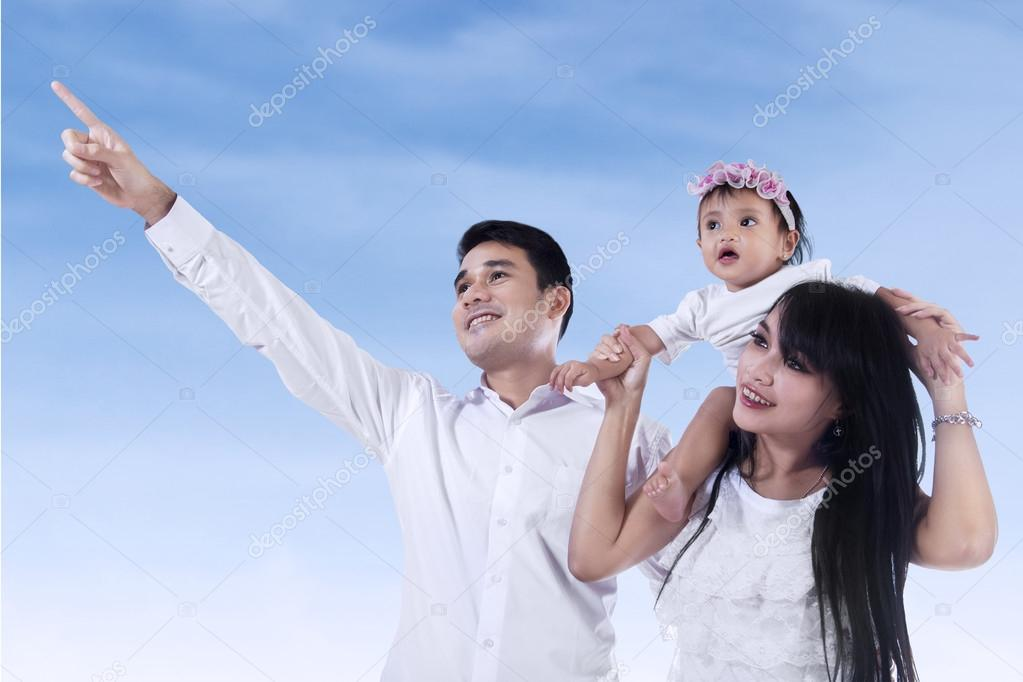 Happy family looking at copyspace
