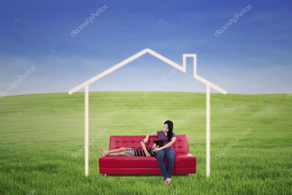 Mother and son in dream house outdoor