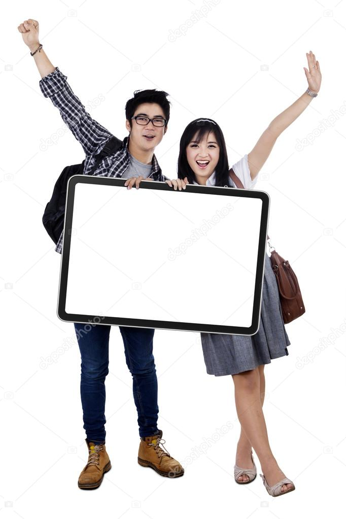 Cheerful students holding copy space
