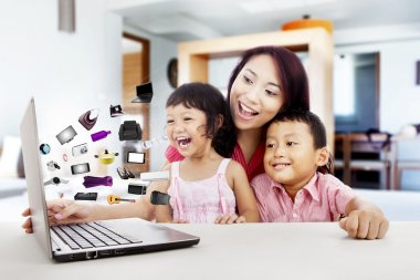Happy asian family shopping online