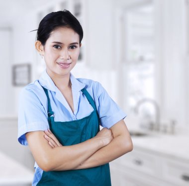 Confident female housekeeper