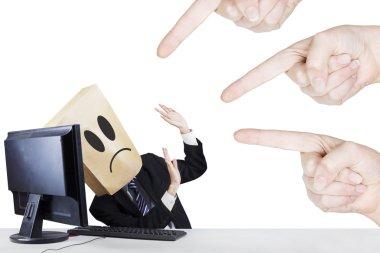 Businessman with carton head bullied