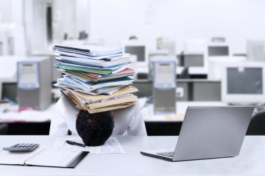 Businessman with documents on his head 1