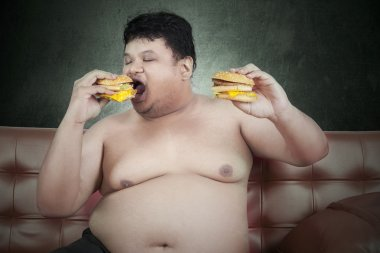 Greedy fat man eating hamburger 3