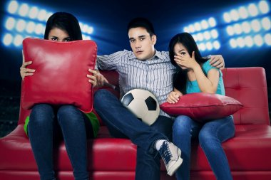 Soccer fans watching tv 1