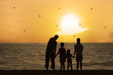 Happy family watching sunset 1