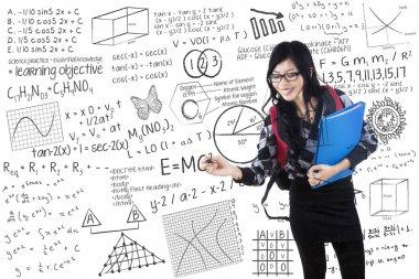 Student writes formula on whiteboard