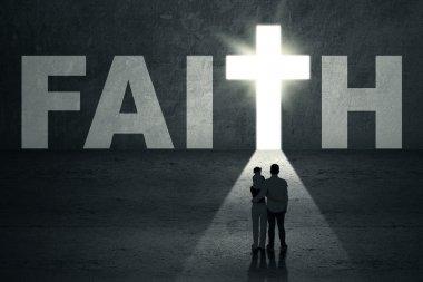 Rear view of young christian family walking toward faith door stock vector