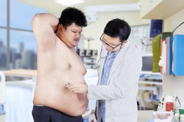 Overweight man checkup in hospital 1