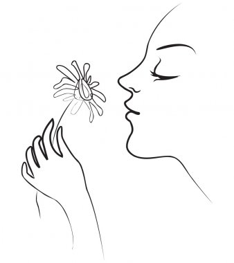 Girl holds in her hand tenderly daisy
