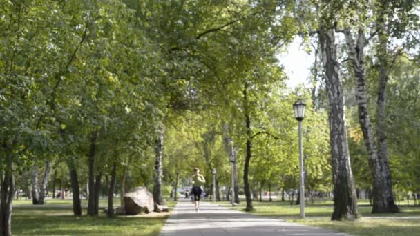 Sport woman running in park