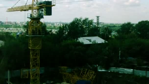 Builders installing construction crane