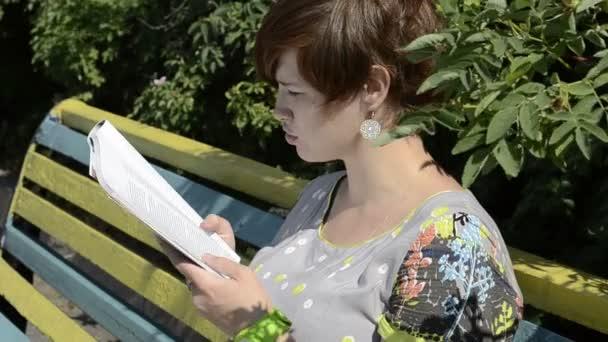Pregnant woman reading magazine
