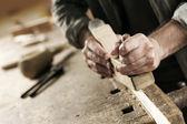 Fotografie ruce řemeslníka