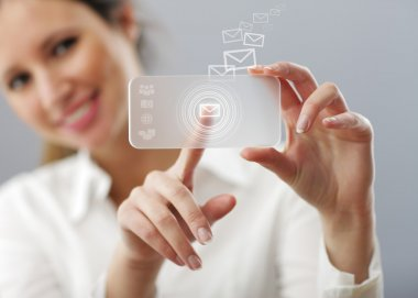 Beautiful woman is typing a mail on her innovative smart