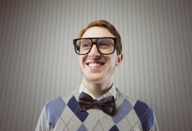 Nerd student making a funny smiling face