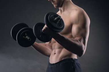 Exercising biceps with dumbbells