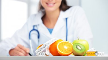 Nutritionist female Doctor in her office. Focus on fruit stock vector