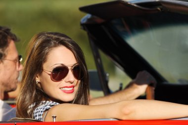 Portrait of a couple in a convertible car