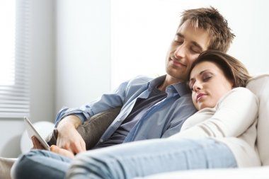 Couple sleeping on sofa
